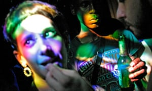 girl takes ecstasy pill in club Shoreditch