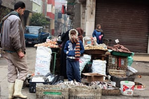 Cairo one year on : A boy stands next to a stall at  Magra El-Oyoun market in Cairo, Egypt