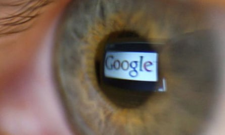 Google logo reflected in person's eye