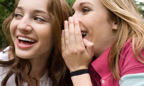 Two teenage girls gossiping