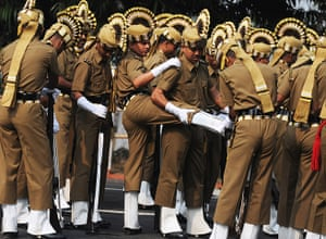 India Republic Day: An Indian soldier helped by other before the parade in Kolkata