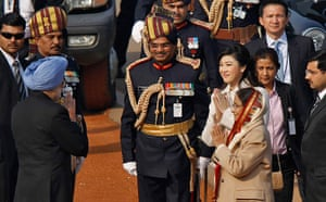 India Republic Day: Manmohan Singh is greeted at the Republic Day parade in New Delhi