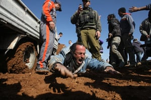 24 hours in pictures : An injured Palestinian construction worker in al-Dirat, West Bank