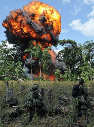 24 hours in pictures : Anti-narcotics police blow up a  FARC cocaine processing laboratory