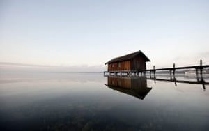 24 hours in pictures : A boathouse on a landing stage on the Ammersee