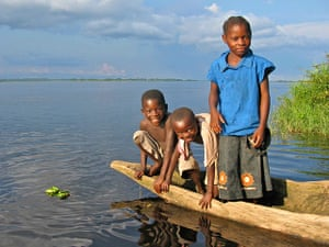congo: Kids playing by riverside