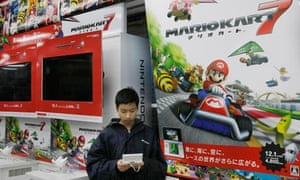 Man plays with Nintendo 3DS console in Japanese shop