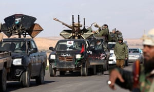 Former Libyan rebel fighters mass at the al-Estada settlement, 30 miles from Bani Walid