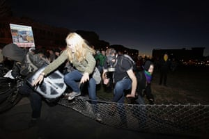 Occupy Oakland: Protestors knock down fences to escape from the police in Oakland