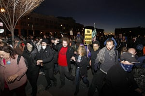 Occupy Oakland: Protestors knock down fences to get away from the police in Oakland