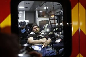 Occupy Oakland: A protestor receives medical attention in an ambulance after being arrested