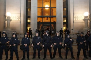 Occupy Oakland: Police officers protect the Oakland City Hall