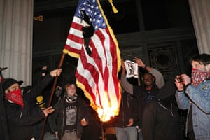 Occupy Oakland: Protestors burn an American flag found inside Oakland City Hall