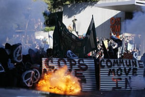 Occupy Oakland: Occupy Oakland demonstrators shield themselves from tear gas
