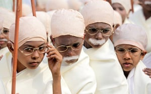Gandhi world record event: Indian boys dressed as Mahatma Gandhi participate in a peace rally