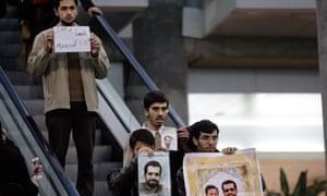 Iranian protesters await the arrival of the IAEA inspectors at Tehran's Imam Khomeini airport