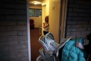 Hope Gardens : Lindzy Earp, 10, watches her mother push her sister into their apartment