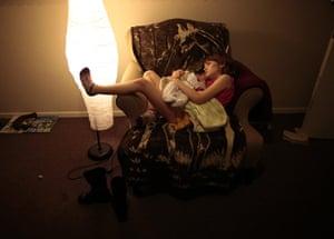 Hope Gardens : Lilly Earp hugs her five week old sister Emily