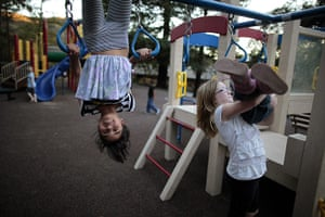 Hope Gardens : Lindzy Earp, left, plays in the playground at Hope Gardens Family Center