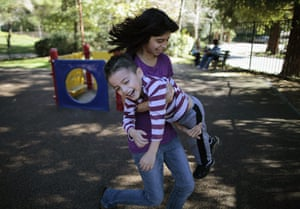 Hope Gardens : Daniella Flores carries her brother Brandon Flores