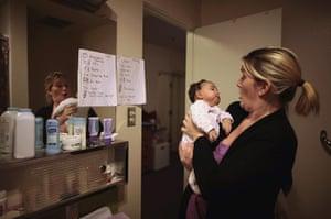 Hope Gardens : Doreen Earp holds her daughter Emily in their apartment