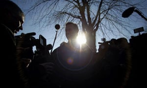 Rick Santorum surrounded by the media at a campaign stop in Polk City, Iowa