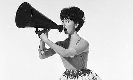 A sixties fashion model holding a megaphone