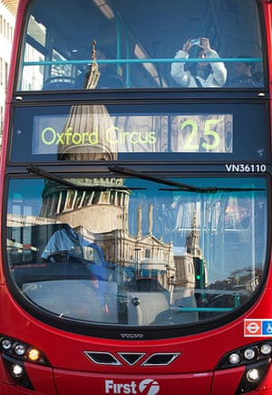 Reflections: A reflection of St Pauls on the windscreen of a passing bus