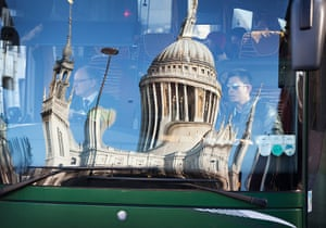 Reflections: A reflection of St Pauls on the windscreen of a passing coach