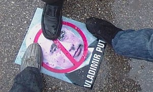 Syrian demonstrators step on Russian Prime Minister Vladimir Putin's poster