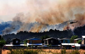 Chile forest fire: Helicopters fight a massive forest fire affecting the commune of Quillon
