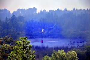 Chile forest fire: Helicopter collecting water around Quillon
