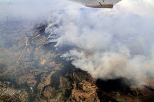 Chile forest fire: Aerial view of smoke billowing a forest fire affecting Quillon, Chile