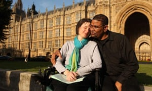 Debbie Purdy and husband Omar Puente outside House of Lords