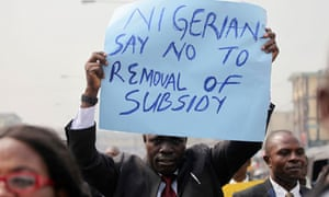A protester holds up a placard in Lagos