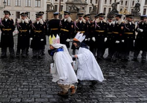 Epiphany: Two boys dressed up as the Three Wise Men run past by Czech Honour Guards