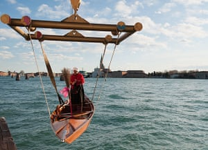Epiphany: A participant's boat launched in the lagoon for the 34th  Befana Regatta