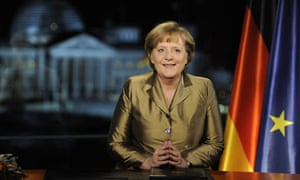 German Chancellor Merkel poses for photographs after recording of her annual New Year's speech