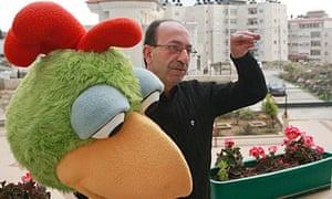 Shara'a Simsim's Kareem held by actor Rajai Sandouka