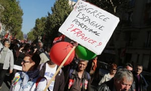 """A demonstrator holds a placard which reads: """"Greece, Spain, Portugal, France?"""" during a rally to protest against the austerity measures announced by the French government, in Paris, Sunday, Sept 30, 2012."""