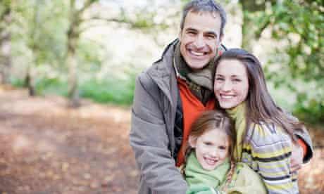 Smiling family hugging
