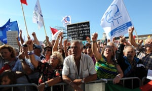 Protesters hold banners during a demonstration in Lisbon, Portugal, on Sept. 29, 2012.