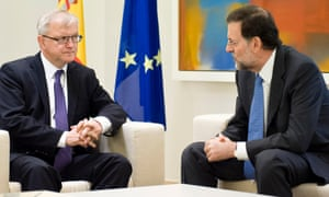 Spain's Prime Minister Mariano Rajoy, right, talks with European Commissioner for Economic and Monetary Affairs Olli Rehn during a meeting at the Moncloa Palace, in Madrid, Monday, Oct. 1, 2012.