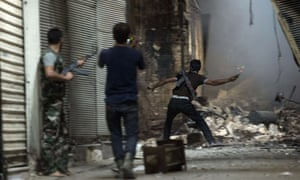 Syrian rebels take position during clashes with regime forces in the old city of Aleppo in northern Syria on Sunday.