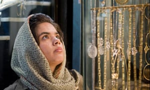An Iranian woman browses in a gold shop