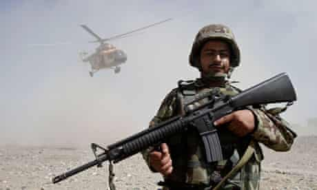 An Afghan soldier stands guard