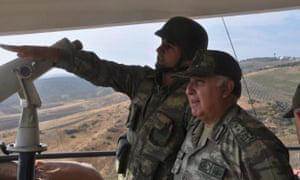 Turkish chief of staff General Necdet Ozel receiving a briefing at a military point during his visit to the Turkey- Syria border in Kilis on Tuesday.