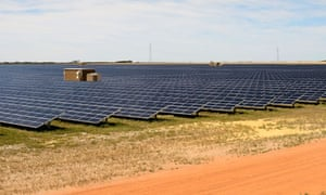 Rows of solar panels at the Greenough River Solar project near the town of Walkaway, Australia