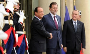 French President Francois Hollande (L) greets Spanish Prime Minister Mariano Rajoy (R) upon his arrival at the Elysee Palace to attend the Franco-Spanish Summit in Paris, France.