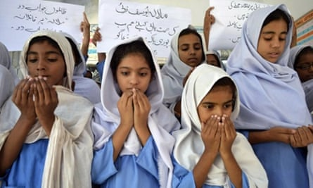 School girls pray for the recovery of gunshot victim, Malala Yousafzai, in Multan, Pakistan. Doctors removed a bullet from the 14-year-old child campaigner shot by the Taliban in a horrific attack condemned by national leaders and rights activists. The attack took place in Mingora, the main town of the Swat valley in Pakistan's northwest, where Malala had campaigned for the right to an education during a two-year Taliban insurgency.